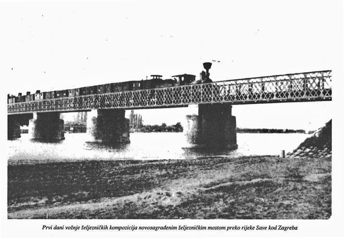"""Željeznička kompozicija na """"novosagrađenom"""" željezničkom mostu preko Save"""